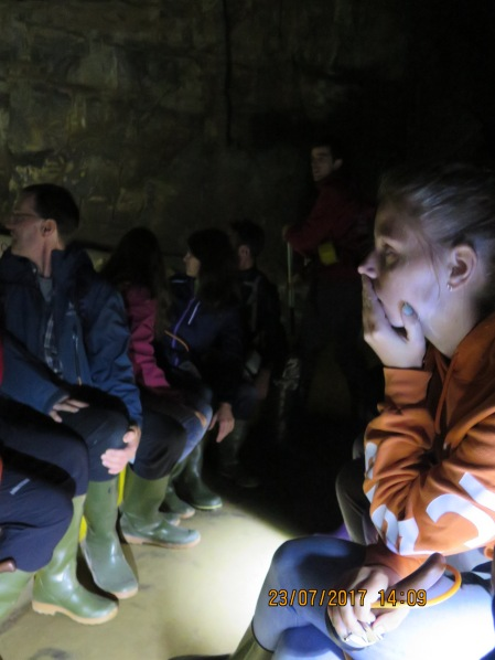 listening intently to the guide as we float on the underground lake