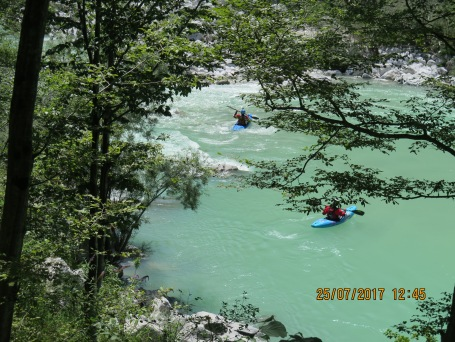 Paddlers on the river, don't you love the color of the water?