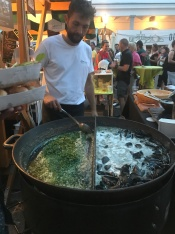 Fresh mussels being cooked at the market