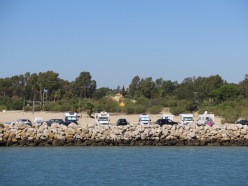 Check out the camper vans parked at the beach El Puerto de Santa Maria