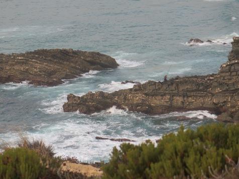 Fishing on the rocks at Zambujeira do Mar, Alentejo Portugal