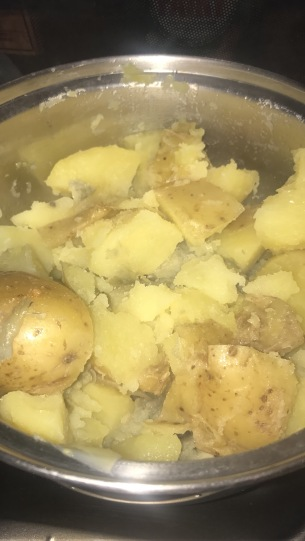 Boiled potatoes with lots of olive oil
