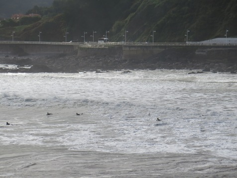 surfers out in force at Candás, Spain