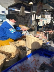 Selling seafood in the Galway city market on a Saturday morning