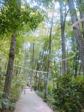 "This metal ribbon winds it way around the garden :""Les Jardins de l'Imaginaire""."
