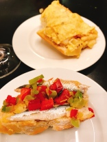 """house speciality of """"tortilla (omelette) on bread, and an sardine with peppers, in Pamplona Spain"""