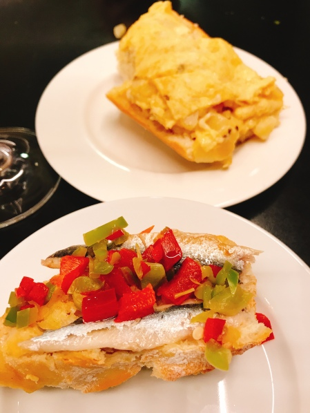 "house speciality of ""tortilla (omelette) on bread, and an sardine with peppers, in Pamplona Spain"