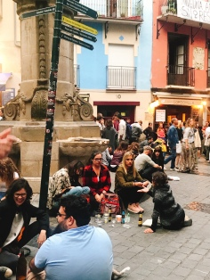 Look at these girls on a night out all just sitting on the ground enjoying themselves, in Pamplona Spain